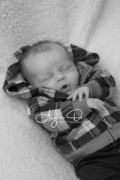Baby Damien making a face. Photo by Angie D-Photography.